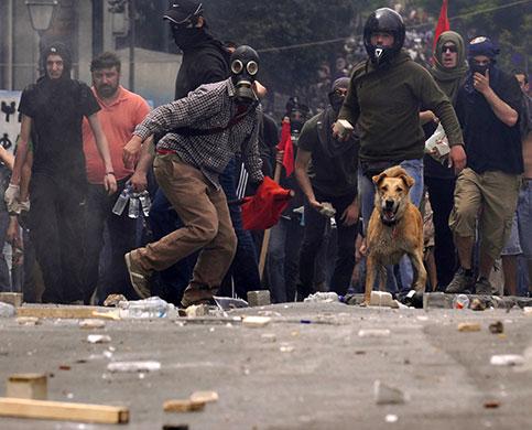 5-May-Demonstrators-throw-014